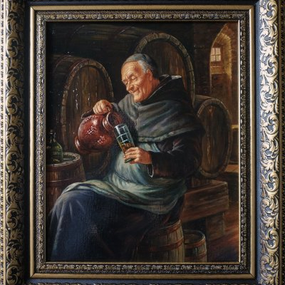 Monk pouring wine