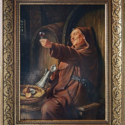 A monk with a glass of wine.