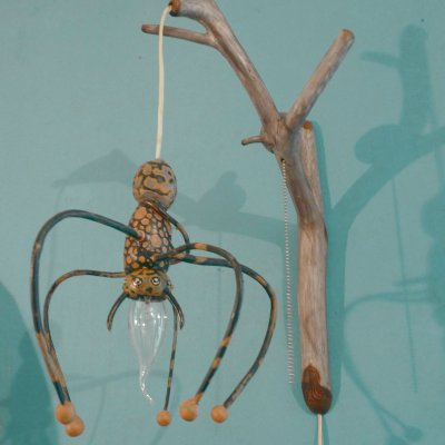 Pouchek on the branch of the sconce