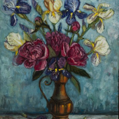 peonies and irises in a copper jug.