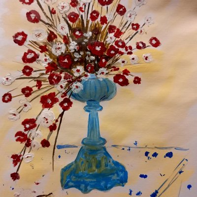 Bouquet of flowers in an antique lamp